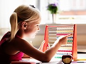 Girl using abacus at desk