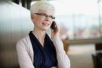 Portrait of mature businesswoman talking on cell phone