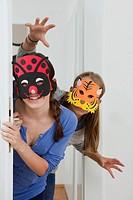 Smiling girls wearing colorful masks