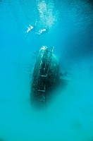 Divers explore the wreck of a sunken fishing boat in the Rock Islands.