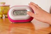 USA, Illinois, Metamora, Child´s 10_11 hand pushing alarm clock