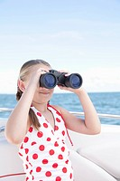 USA, Florida, St. Petersburg, Girl 10_11 on yacht looking through binoculars
