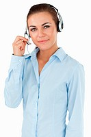 Young female call center agent against a white background