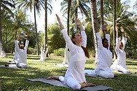 Group Yoga Session on the lawn at Shreyas Retreat near Bangalore, India                                                                               ...