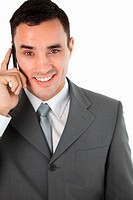 Close up of friendly smiling businessman on the phone against a white background