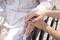 Nurse Touching Patient´s Hands