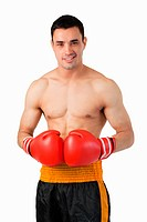 Confident smiling boxer against a white background