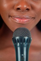 Close up of female lips with microphone