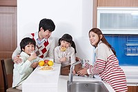 Happy family on the kitchen top eating