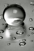 Abstract still-life  Water droplets over steel surface