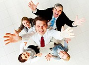 Above view of happy employer looking at camera with several partners around him