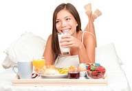 Continental Breakfast in bed _ woman isolated