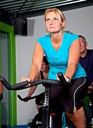 Mature woman in spinning class