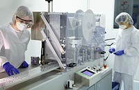 Technicians performing in-process control of tablets in a blister packaging, Clean room, Pharmaceutical plant, Drug manufacturing plant, Research Cent...