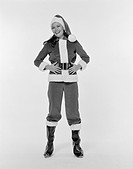 Young woman wearing santa costume, smiling, portrait