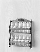 Empty spice bottles on rack