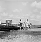 Family walking beside cannons