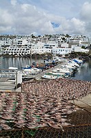 PUERTO DEL CARMEN LANZAROTE Yacht marina harbour and fish drying on cages in old town harbour