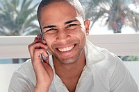 Attractive young mulato man speaking on her mobile phone