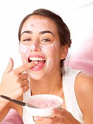 Woman tasting fruit face mask
