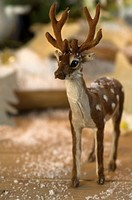 Deer figurine and fake snow