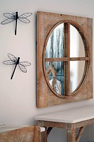 Dressing table with mirror and decorative dragonflies on the wall