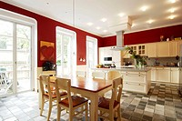 Open plan kitchen with dining area and tiled floor