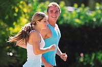 Young Couples Jogging Outdoor in the Sunny Day