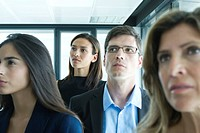 Business associates, focus on woman in background