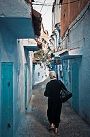 Woman walking, Chefchaouen, Morocco