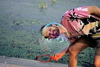Man looks through a bubble
