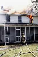Firefighters fighting a house on fire in Bowie, Maryland