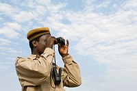 Watching out! African policemen with binoculars