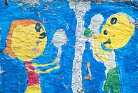 detail on a child´s painting after it has been left outside in the weather.