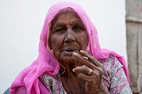 Mature woman smoking - Shyampura Village, Rajasthan, India