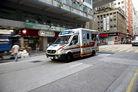 ambulance speeding through the streets of western district hong kong island, hksar, china
