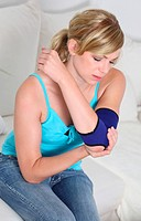 Woman with bandage on elbow