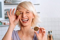 Laughing woman with coin made of chocolate