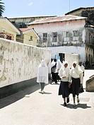 Tanzania, Zanzibar, Stone Town. Girls leaving school.