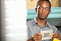 Black man working in electronics factory