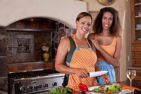 Sisters cooking in kitchen together