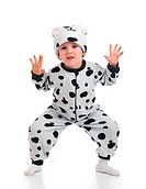 Little boy dressed in a Dalmatian suit.