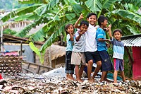 Bali, Indonesia. It is common to see families living, and children playing, in dangerously unsanitary illegal trash dumps. Illness is rampant and life...