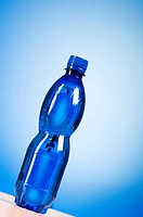Bottle of water against colorful gradient background