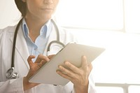 Hispanic doctor using digital tablet