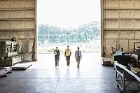 Boss and workers walking in warehouse
