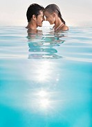 Couple enjoying swimming pool together