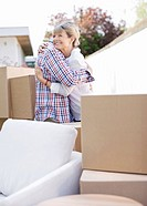 Couple hugging near moving boxes