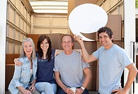 Friends at back of moving van, one holding a comment bubble