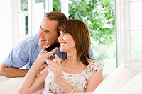 Couple listening to cell phone together